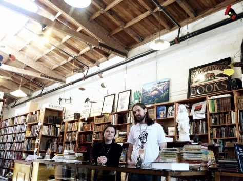 Old Capitol Books manager Stephanie Spoto and bookseller Brian Sheffield organize literary events..