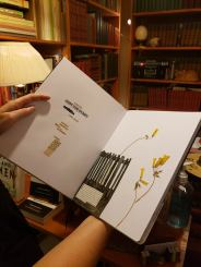 Clairette Durand-Gasselin holds one of her art journals